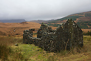Ruined farm building and distant Glen More, Isle of Mull, Scotland.
