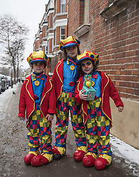 © Licensed to London News Pictures. 01/03/2018. London, UK. Three orthodox Jewish children in fancy dress celebrate the festival of Purim on the streets of Stamford Hill in north London on March 1, 2018. Purim celebrates the miraculous salvation of the Jews from a genocidal plot in ancient Persia, an event documented in the Book of Esther. Traditionally the jewish community wear fancy dress and exchange reciprocal gifts of food and drink. Photo credit: Ben Cawthra/LNP