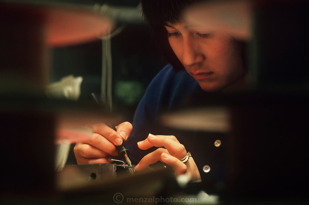 Cynthia Ferrell soldering at the M.I.T., Insect Robot Lab, Cambridge, MA. Robo sapiens Project.