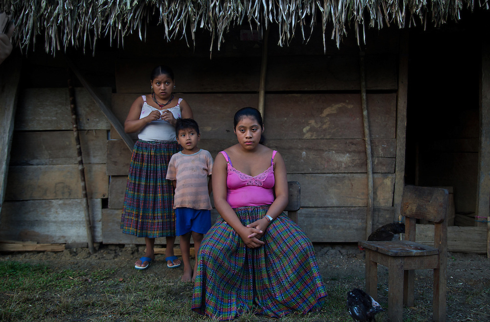 """Carmen, 14, who is 3 months pregnant, sits with family members at her in laws house where she lives with 7 of his family members. """"I was sad because I didn't want to be pregnant,"""" she said. """"I was just sad, I don't know why.""""   """"I was in school until 5th grade, when I got married. I have been raising my chickens to kill them when the baby is born."""""""