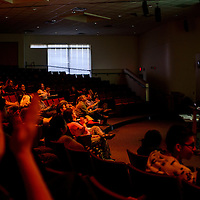 A crowd applauds Mick Burson at the end of a lecture at his work at UNM-Gallup Tuesday.