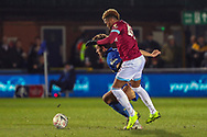 AFC Wimbledon defender Will Nightingale (5) battles for possession with West Ham United Grady Diangana (45) during the The FA Cup match between AFC Wimbledon and West Ham United at the Cherry Red Records Stadium, Kingston, England on 26 January 2019.