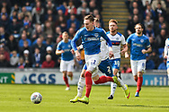Rochdale Defender, Ryan McLaughlin (2) and Portsmouth Midfielder, Ronan Curtis (11) chase the ball during the EFL Sky Bet League 1 match between Portsmouth and Rochdale at Fratton Park, Portsmouth, England on 13 April 2019.