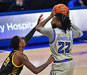 St Louis Billikens forward Terrence Hargrove Jr. (22, right) looks to pass as he is pressured by Arkansas-Pine Bluff Golden Lions guard Shaun Doss Jr. (21). St. Louis University hosted the University of Arkansas - Pine Bluff in a mens basketball game on December 5, 2020 at Chaifetz Arena on the SLU campus in St. Louis, MO.<br /> Photo by Tim Vizer