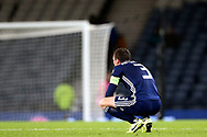 The crowds have gone - the game is lost and captain Scotland defender Andrew Robertson (3) (Liverpool) is left alone with his thoughts and disappointment during the UEFA European 2020 Qualifier match between Scotland and Russia at Hampden Park, Glasgow, United Kingdom on 6 September 2019.