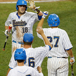 Jun 25, 2013; Omaha, NE, USA; UCLA Bruins second baseman Cody Regis (18) is congratulated for scoring during the sixth inning in game 2 of the College World Series finals against the Mississippi State Bulldogs at TD Ameritrade Park. Mandatory Credit: Derick E. Hingle-USA TODAY Sports
