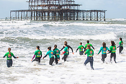 © Licensed to London News Pictures. 08/06/2019. Brighton, UK. Members of the Brighton Surf Life Saving Club brave the rough seas and strong winds on Saturday morning as the remnants of storm Miguel pass by Brighton and Hove. Photo credit: Hugo Michiels/LNP