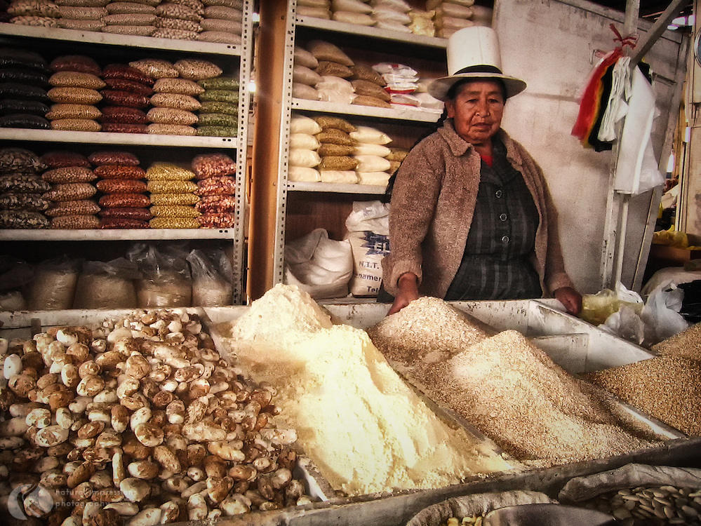Quechua woman selling fresh ground cornmeal and potatoes near Cusco and the Sacred Valley.