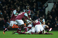 Angelo Ogbonna Obinze of West Ham United (hidden)celebrates scoring his sides 2nd goal during 2nd Extra time to make it 2-1 as he is mobbed by his teammates. The Emirates FA cup, 4th round replay match, West Ham Utd v Liverpool at the Boleyn Ground, Upton Park  in London on Tuesday 9th February 2016.<br /> pic by John Patrick Fletcher, Andrew Orchard sports photography.