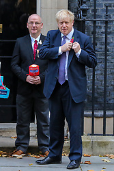 © Licensed to London News Pictures. 28/10/2019. London, UK. The Prime Minister BORIS JOHNSON wears a poppy outside No 10 Downing Street door. Later today MPs will vote on BORIS JOHNSON's motion on a general election on December 2019. Photo credit: Dinendra Haria/LNP