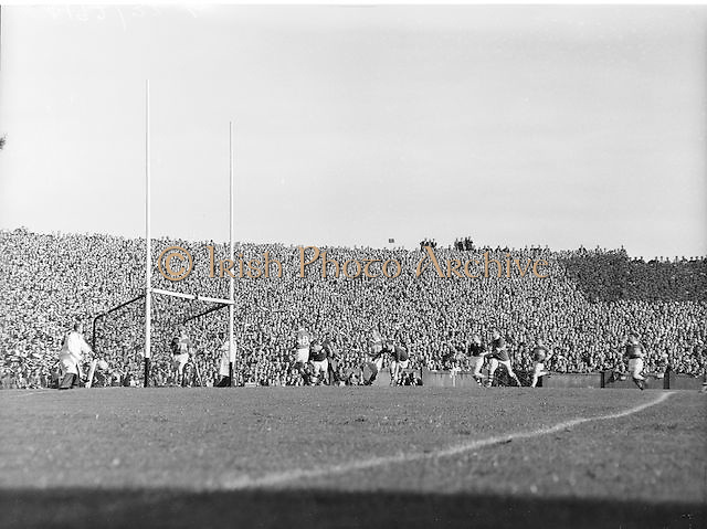 View of the crowd and pitch during the All Ireland Senior Gaelic Football Championship Final, Kerry vs Galway in Croke Park on the 27th September 1959. Kerry 3-7 Galway 1-4.