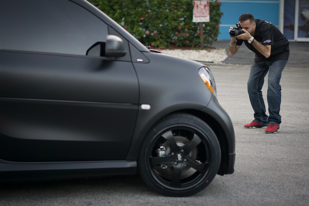 DORAL, FLORIDA, DECEMBER 11, 2015<br /> Alex Vega, owner of The Auto Firm, a South Florida car customizing and restoring shop which has a vast clientele of professional athletes and entertainers, takes photos of a customized Smart Car. The vehicle was done for former NFL player Chad Johnson, also known as Ochocinco.<br /> (Photo by Angel Valentin/Freelance)