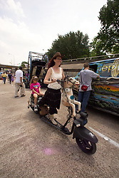 Stock photo of a woman with a horse scooter