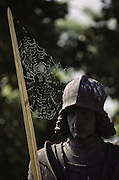 Charles Bridge statue with cobwebs between the sword and the soldier's helmet. Prague, Czech Republic.