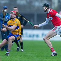 Clare's Niall Deasy in action against Cork's Robert Downey
