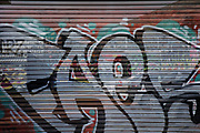 Graffiti on a garage entrance in the area of Digbeth  in central Birmingham, United Kingdom.  Following the destruction of the Inner Ring Road, Digbeth is now considered a district within Birmingham City Centre. As part of the Big City Plan, Digbeth is undergoing a large redevelopment scheme that will regenerate the old industrial buildings into apartments, retail premises, offices and arts facilities. There is still however much industrial activity in the south of the area.