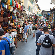 Vendors and shoppers converge in the San Lorenzo Leather Market in Florence, Italy.