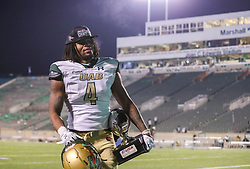 Dec 18, 2020; Huntington, West Virginia, USA; UAB Blazers running back Spencer Brown (4) walks off the field with the MVP trophy after defeating the Marshall Thundering Herd for the USA Conference Championship at Joan C. Edwards Stadium. Mandatory Credit: Ben Queen-USA TODAY Sports