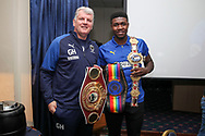 AFC Wimbledon manager Glyn Hodges with Boxer Lerrone Richards during the EFL Sky Bet League 1 match between AFC Wimbledon and Peterborough United at the Cherry Red Records Stadium, Kingston, England on 18 January 2020.