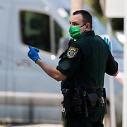 Seminole County offers free drive-thru Coronavirus (Covid-19) swab testing at the Apostolic Church of Jesus Christ on Tuesday, April 21, 2020 in Altamonte Springs, Florida. (Alex Menendez via AP)