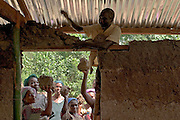 Togolese refugees work building a mud-brick house in a small village along the Togolese border, Eastern Ghana. Thousands of Togolese citizens crossed the border into Ghana after the violence that followed presidential elections in April 2005. Partly because of strong cultural ties between populations on both sides of the border, Togolese refugees were able to enjoy the relative hospitality of their Ghanaian neighbours, and are today scattered in various villages across the border. The UNHCR complains that, since the refugees aren't concentratred in large camps, media attention has been minimal, and that it has been very difficult to attract funding.