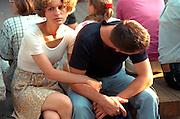 Woman comforting upset boyfriend age 25 during street festival.  Zakopane Poland