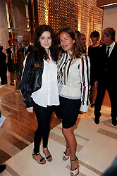 Left to right, AMBA JACKSON and her mother JADE JAGGER at a party to celebrate the opening of the Louis Vuitton Bond Street Maison, New Bond Street, London on 25th May 2010.