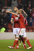 Nottingham Forest forward Apostolos Vellios (39) and Nottingham Forest midfielder Adlene Guedioura (5) celebrate after scoring a goal to make it 3-0 during the EFL Sky Bet Championship match between Nottingham Forest and Barnsley at the City Ground, Nottingham, England on 24 April 2018. Picture by Jon Hobley.