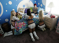 8-year-old Sammy Heim chats with San Diego Chargers cheerleaders, Kristina Stewart, 25, Ashley Borden, 22, and Ashley Ware, 22, from left, during a visit to her Yorba Linda home Saturday November 4, 2006.  Heim, a Pop Warner chearleader, was recently diagnosed with rhabdomyosarcoma, a form of cancer that usually affects children under the age of 10.