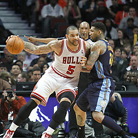 26 March 2012: Chicago Bulls power forward Carlos Boozer (5) posts up Denver Nuggets small forward Wilson Chandler (21) during the Denver Nuggets 108-91 victory over the Chicago Bulls at the United Center, Chicago, Illinois, USA. NOTE TO USER: User expressly acknowledges and agrees that, by downloading and or using this photograph, User is consenting to the terms and conditions of the Getty Images License Agreement. Mandatory Credit: 2012 NBAE (Photo by Chris Elise/NBAE via Getty Images)