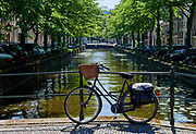 Bicycle on bridge above canal in center of The Hague, Netherlands