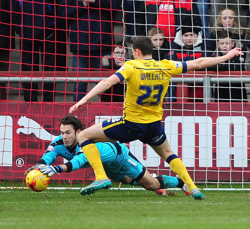 Fleetwood Town's Chris Maxwell makes a save at the feet of Scunthorpe United's Murray Wallace<br /> <br /> Photographer Chris Vaughan/CameraSport<br /> <br /> Football - The Football League Sky Bet League One - Fleetwood Town v Scunthorpe United  - Saturday 20th February 2016 - Highbury Stadium - Fleetwood    <br /> <br /> © CameraSport - 43 Linden Ave. Countesthorpe. Leicester. England. LE8 5PG - Tel: +44 (0) 116 277 4147 - admin@camerasport.com - www.camerasport.com