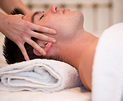 Man receiving a head and face massage