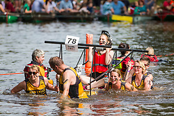 © Licensed to London News Pictures. 09/06/2018. Knaresborough UK. Competitors crossing the river Nidd during the Knaresborough bed race today. Knaresborough bed race is taking place today in the town of Knaresborough in Yorkshire. The race first held in 1966 is part fancy dress & part gruelling time trial over a 2.4 mile course ending with a swim through the River Nidd. Photo credit: Andrew McCaren/LNP
