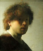 Self-Portrait of Rembrandt Harmensz van Rijn (1606-1669), oil on panel, c1628. Even as an inexperienced young artist, Rembrandt did not shy away from experimenting.  Here the light glances along his right cheek, while the rest of his face is veiled in shadow.  It takes a while to realise that the artist is gazing intently out at us.  Using the butt end of his brush,  Rembrandt made scratches in the still wet paint to accentuate the curls of his tousled hair..