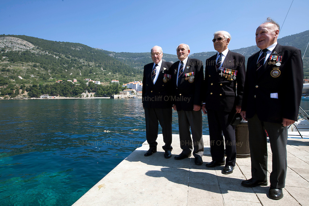 Mcc0031516 . Daily Telegraph..(L to R) Peter Bickmore BEM,Reg Ellis, Flt Lt Freddie Nicoll and John Rivett after Commemorative wreaths are thrown into the Adriatic sea of the jetty in the fishing town of Komiza on the island of Vis where British forces were based during WWII .. A reunion of British WW2 Veterans, probably for the last time. They are some of the last survivors of an Allied combined garrison of Royal Navy, Royal Marine Commandos, Army and Royal Air Force personnel who took over the Island of Vis in 1943 and held it until the end of the War. From here they harried Axis Forces in what was Yugoslavia, providing supply drops to the Partisans and, at one point, refuge for Marshall Tito when he was nearly captured by German Forces ...19 May 2011 Vis, Croatia