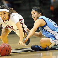 021114  Adron Gardner/Independent<br /> <br /> Many Farms Lobo Bianca Yazzie (23), left, lunges for a ball away from Window Rock Scout Naomie Klah (32)  in Chinle Tuesday.