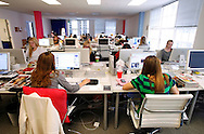 Gossip girl, Molly Goodson, a native of Newton, Mass. and editor at PopSugar.com, a celebrity gossip website, works at her desk next to her coworker, Katie Emswiler, left, at the Sugar Inc. office in San Francisco on Monday, November 19, 2007. (Jakub Mosur/For the Boston Globe)
