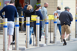 ©Licensed to London News Pictures 30/04/2020  <br /> Dartford, UK. People queuing outside B&Q warehouse store in Dartford, Kent. B&Q have today opened all of its 288  stores in the UK. The DIY retailer has strict social distancing measures in place. Photo credit:Grant Falvey/LNP