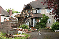 © Licensed to London News Pictures. 03/06/2014. Kings Norton, Birmingham, West Midlands. The scene in Beaks Hill Road, Kings Norton, Birmingham where the structure of a house collapsed. Photo credit : Dave Warren/LNP