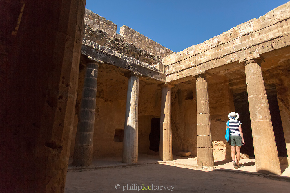 Female tourist exploring old ruins, Paphos Archaeological Park, Paphos, Cyprus