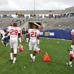 Oct 31, 2009; East Hartford, CT, USA; Rutgers cornerbacks Zaire Kitchen (29), Devin Mccourty (21) and Khaseem Greene (20) leave the field after Rutgers' 28-24 victory over Connecticut in Big East NCAA football at Rentschler Field.