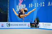 Staniouta Melitina during qualifying at hoop in Pesaro World Cup April 10, 2015. Melitina is an Belarusian rhythmic gymnast, she was born in November 15, 1993 in Minsk. She is a three time World All-around bronze medalist in 2015, 2013, 2010 retired from rhythmic gymnastics in December 2016.