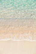 Sand and wave on beach on summer sunny day, Beach of Porticcio, Gulf of Ajaccio, Corsica, France