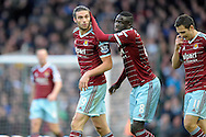 Cheikhou Kouyate of West Ham United celebrates with Andy Carroll of West Ham United (l) after Carroll  scores his second goal to make it 2-1. Barclays Premier league match, West Ham Utd v Swansea city at the Boleyn ground, Upton Park in London on Sunday 7th December 2014.<br /> pic by John Patrick Fletcher, Andrew Orchard sports photography.