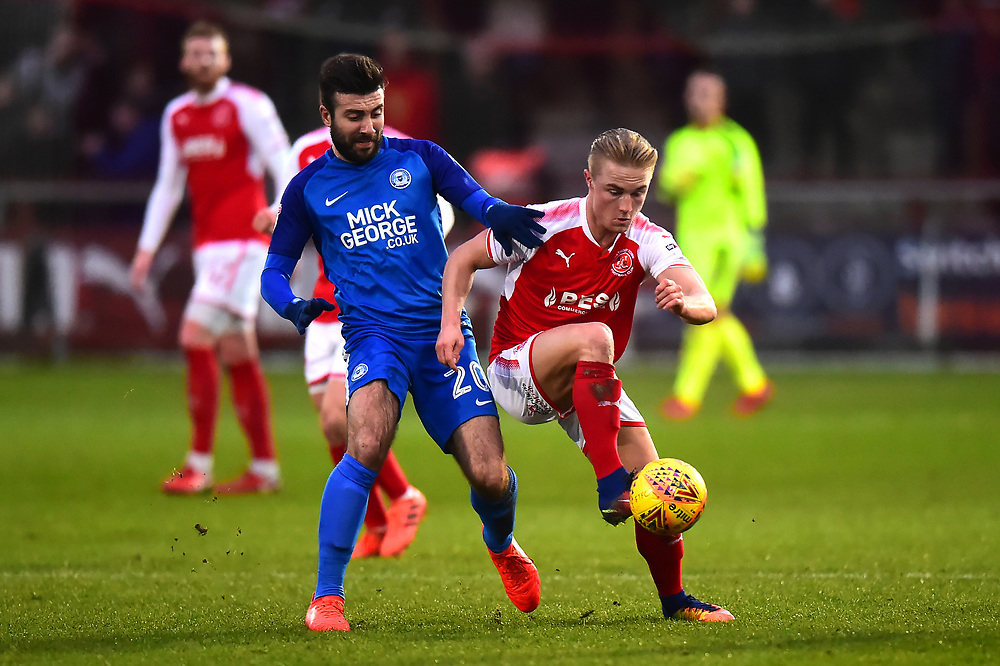 Fleetwood Town's Kyle Dempsey vies for possession with Peterborough United's Michael Doughty<br /> <br /> Photographer Richard Martin_Roberts/CameraSport<br /> <br /> The EFL Sky Bet League One - Fleetwood Town v Peterborough United - Sunday 17th December 2017 - Highbury Stadium - Fleetwood<br /> <br /> World Copyright © 2017 CameraSport. All rights reserved. 43 Linden Ave. Countesthorpe. Leicester. England. LE8 5PG - Tel: +44 (0) 116 277 4147 - admin@camerasport.com - www.camerasport.com