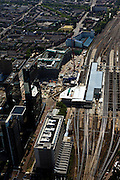 Nederland, Zuid-Holland, Rotterdam, 23-05-2011; Nieuwbouw Centraal Station met nieuwe overkapping voor HSL. Daarnaast het Groothandelsgebouw en in het verlengde daarvan zwarte hoogbouw Delftse Poort aan het Weena . Middenboven de groene bomen van de Graaf Florisstraat..Groothandelsgebouw and the high rise Delftse Poort (multi-business complexes) at the Weena (street )..New construction railway station with new roof for HST. In front of the Delftse Poort the Manhattan Hotel. In front of the Delftse Poort the Manhattan Hotel..luchtfoto (toeslag), aerial photo (additional fee required).copyright foto/photo Siebe Swart