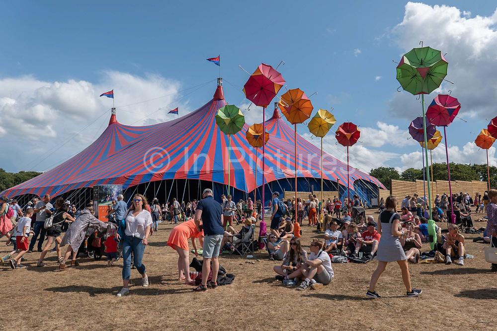 People gather outside the BCC Sounds Stage at Latitude Festival on the 20th July 2019 in Southwold in the United Kingdom.