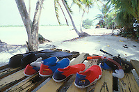 French Polynesia, Islands in the South Pacific, part of the French overseas Territories.Photo by Owen Franken.a honeymoon couple's watershoes and snorkels, On the island of Raniroa...Photo by Owen Franken
