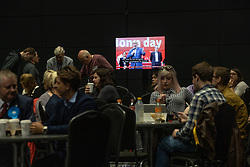 © Licensed to London News Pictures . 26/05/2019. Manchester, UK. People watch Boris Johnson election programming on TV in a canteen at the count venue . The count for seats in the constituency of North West England in the European Parliamentary election , at Manchester Central convention centre . Photo credit: Joel Goodman/LNP